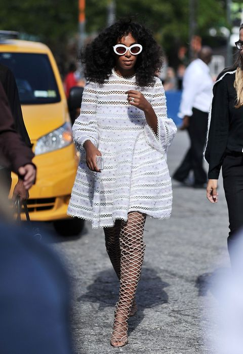 "<p>Who: Solange Knowles</p><p class=""MsoNormal"">When: September 14, 2015</p><p class=""MsoNormal"">Why: Solange is known for out-of-the box styling, and this frilly white Zimmermann dress with thigh-high fishnet boots is no exception.<span></span></p>"