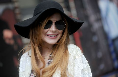 Clothing, Eyewear, Glasses, Vision care, Lip, Hat, Sunglasses, Textile, Fashion accessory, Facial expression,