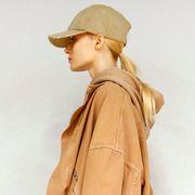Brown, Cap, Sleeve, Shoulder, Collar, Khaki, Standing, Joint, Headgear, Temple,