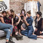 Leg, Trousers, Jeans, Social group, Shirt, Textile, Sitting, Outerwear, Denim, T-shirt,