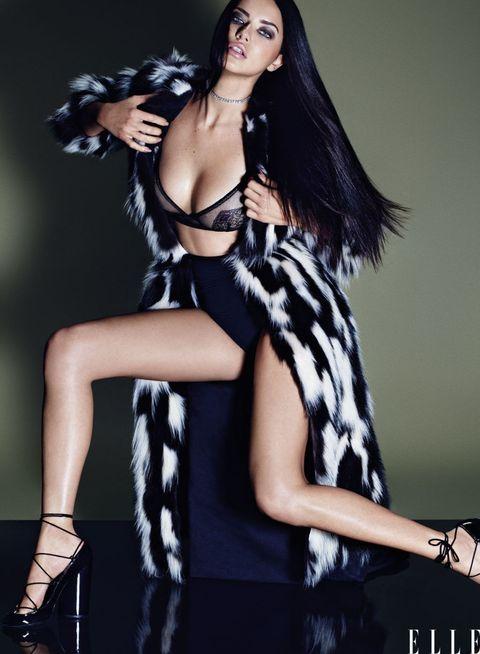 Arm, Hairstyle, Shoulder, Fashion model, Style, Black hair, Fashion accessory, Beauty, Dress, Fashion,