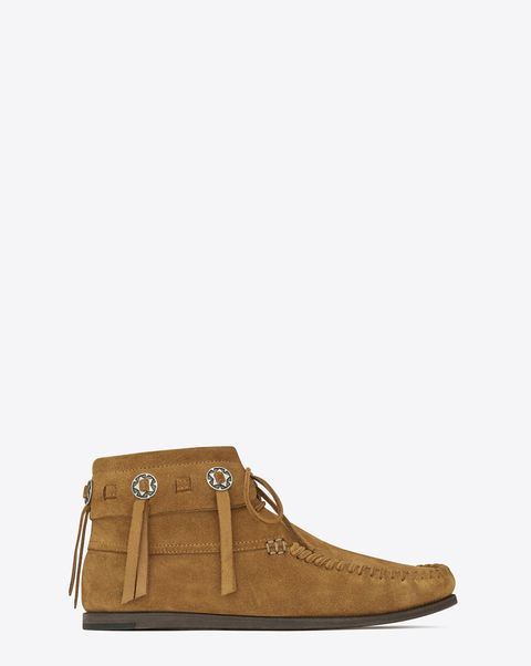 "<p>Saint Laurent Concho Moccasin Desert Ankle Boot, $795; <a href=""http://www.ysl.com/us/shop-product/women/shoes-flat-booties-concho-mocassin-desert-ankle-boot-in-tan-suede_cod44743439ev.html#dept=boots_shoes_women_"">ysl.com</a><br></p>"