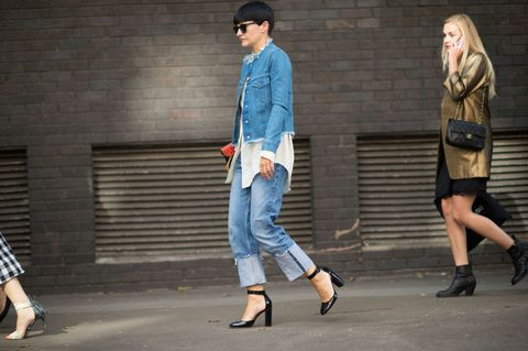 <p>Layer a distressed denim jacket over a long white shirt and jeans. Black patent leather Mary Jane heels elevate the look. </p>
