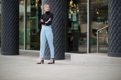 <p>Use a black turtleneck to take summery sky blue trousers into early fall. </p>