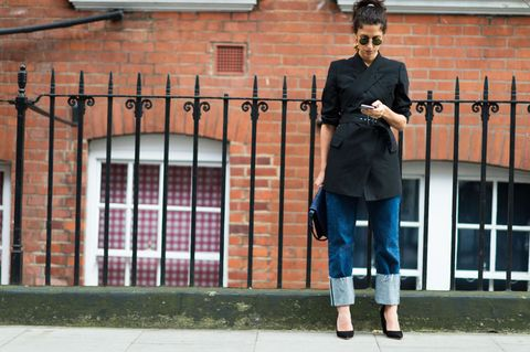 <p>With fall brings cuffing season (in more ways than one). Add a large fold to your jeans and top with a longline jacket. </p>