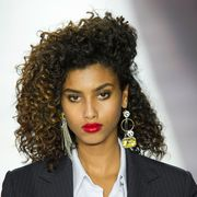 Coat, Hairstyle, Earrings, Chin, Eyebrow, Jheri curl, Outerwear, Collar, Ringlet, Style,