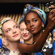 Fashion accessory, Headgear, Hair accessory, Tradition, Eyelash, Headpiece, Photographer, Single-lens reflex camera, Camera, Makeover,