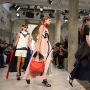 Footwear, Luggage and bags, Fashion, Dress, Crowd, Street fashion, Bag, Travel, Costume, Handbag,
