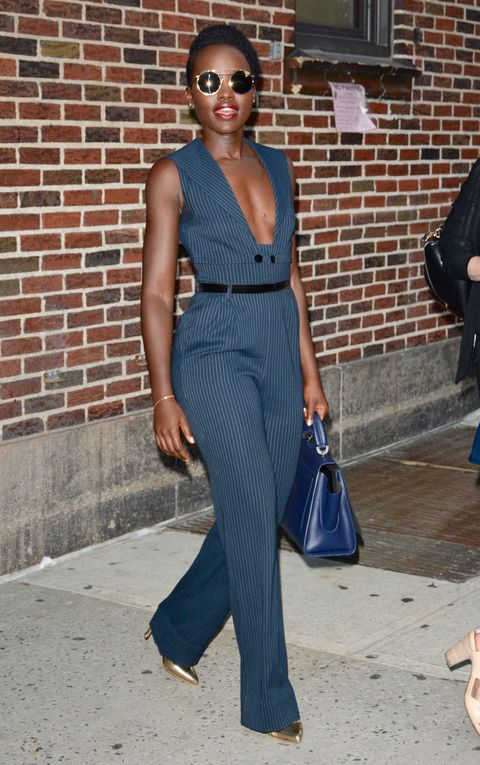 <p>Who: Lupita Nyong'o</p><p>When: September 18, 2015</p><p>Why: Lupita Nyong'o's pinstripe jumpsuit with a plunging neckline will take you from the office (with a camisole underneath) to cocktail hour in one fell swoop. She adds some cool to her look with funky glasses and matching metallic pumps.</p>