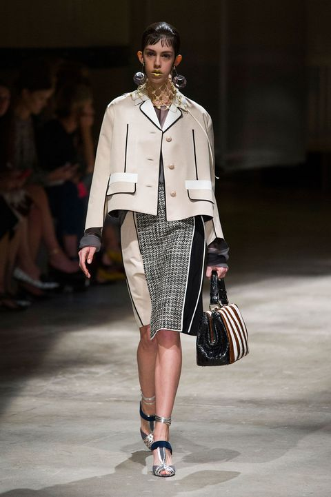 Clothing, Leg, Brown, Shoulder, Joint, Fashion show, Outerwear, Runway, Style, Fashion model,