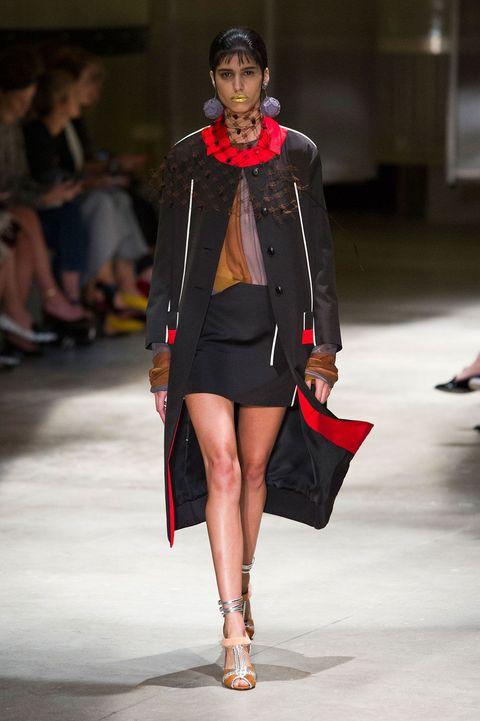 Clothing, Footwear, Leg, Brown, Human leg, Shoulder, Fashion show, Joint, Outerwear, Runway,