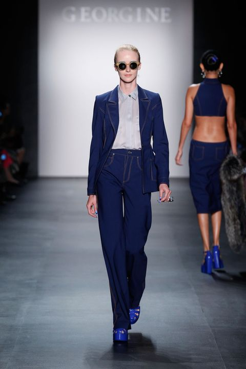 Clothing, Eyewear, Vision care, Human body, Trousers, Fashion show, Shirt, Outerwear, Sunglasses, Style,