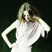 Hairstyle, Green, Sleeve, Human body, Shoulder, Joint, Elbow, Dress, Fashion model, Neck,