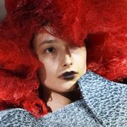 Lip, Chin, Red, Costume accessory, Headgear, Fashion, Costume, Hair coloring, Fur, Red hair,