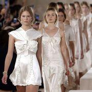 People, Dress, Standing, Fashion, One-piece garment, Day dress, Ivory, Ceremony, Ritual, Fashion design,