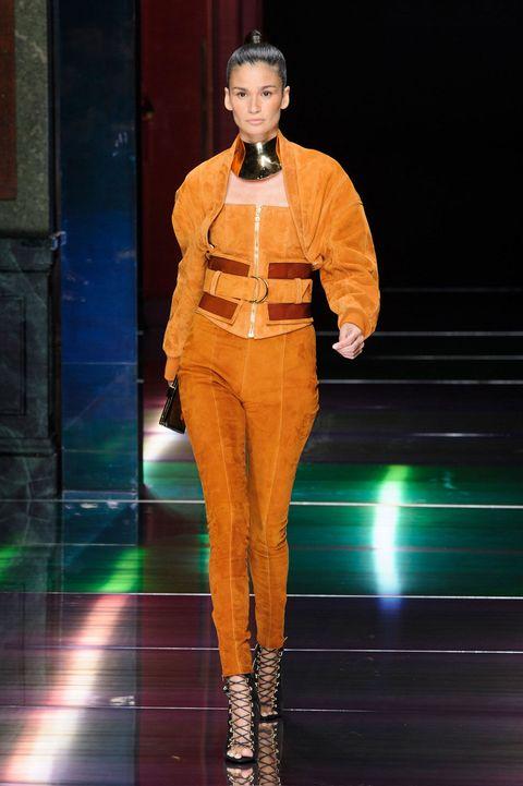 Style, Fashion show, Amber, Fashion accessory, Fashion, Orange, Fashion model, Thigh, Runway, Boot,