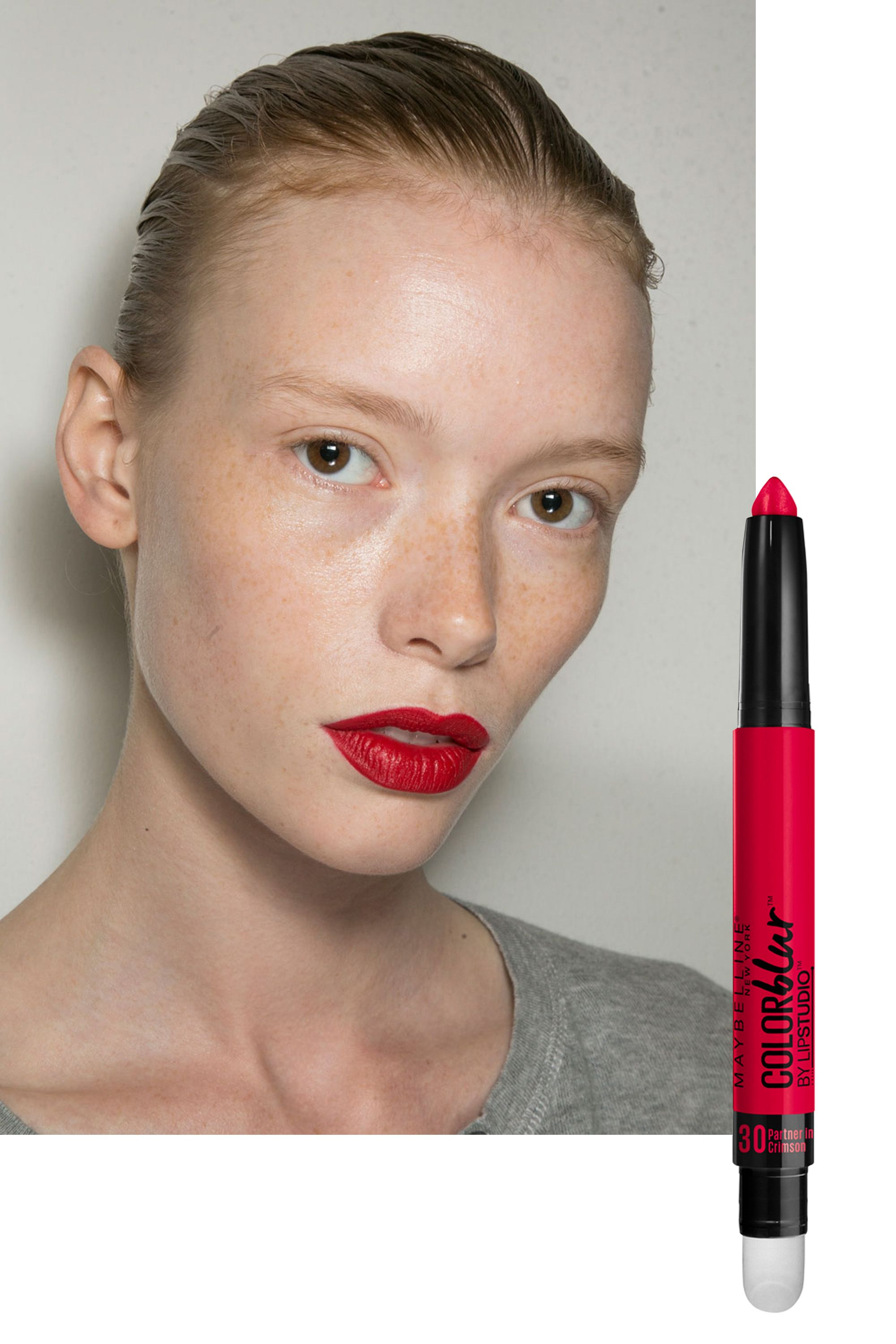 "<p>Makeup artist Yadim topped two shades of liquid lipstick with loose pigment to lend the classic crimson mouth a modern ""velvet"" finish.</p><p><em>For a similar look, try dusting a cherry-colored blush over <a href=""http://www.amazon.com/Maybelline-New-York-Studio-Color/dp/B00YJJXC7G/ref=redir_mobile_desktop?ie=UTF8&dpID=21wt4Vu7QqL&dpPl=1&keywords=maybelline%20color%20blur&pi=SY200_QL40&qid=1443530360&ref=plSrch&ref_=mp_s_a_1_1&sr=8-1"" target=""_blank"">Maybelline New York Lip Studio Color Blur Matte Pencil in Partner in Crimson</a> ($9).</em></p>"