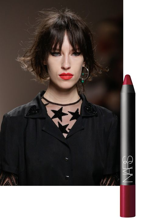 """<p>Face painter Aaron de Mey aimed to """"blast punk and street toughness with luxury."""" In addition to gold glitter and bold swoops of black liner, he alternated between natural and """"perfect, perfect"""" red lips.</p><p>To get the look, try <a href=""""http://www.narscosmetics.com/USA/mysterious-red-velvet-matte-lip-pencil/0607845024774.html"""" target=""""_blank"""">NARS Velvet Matte Lip Pencil in Mysterious Red</a> ($26).</p>"""