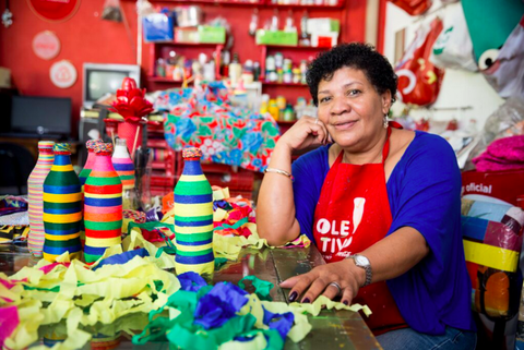 <p>        Regina Maria Silva Gomes, with support from Coca-Cola's Coletivo program, helped clear the once trash-strewn streets of her Brazilian favela and organized local women artisans to transform plastic bottles and other debris into charming bird feeders, toys, and decorative items that are sold for cash. </p>
