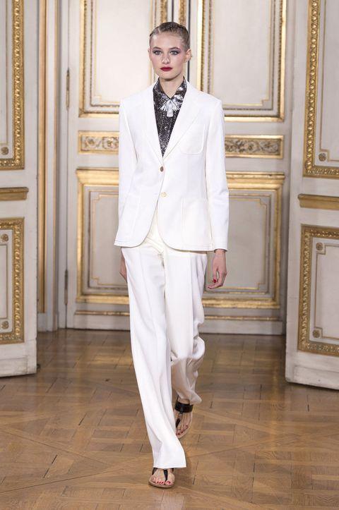 Collar, Outerwear, Floor, Formal wear, Flooring, Style, Suit trousers, Blazer, Neck, Fashion model,