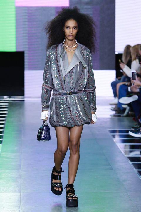 Clothing, Leg, Fashion show, Shoulder, Human leg, Runway, Joint, Outerwear, Fashion model, Style,
