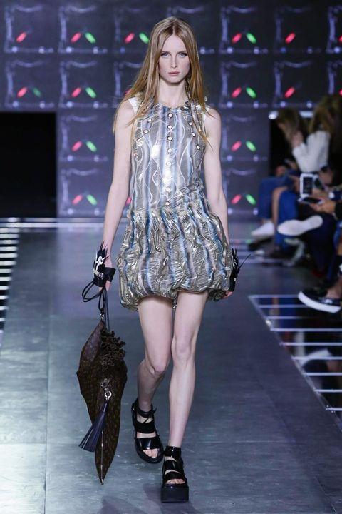 Clothing, Footwear, Leg, Fashion show, Dress, Shoulder, Human leg, Joint, Runway, Fashion model,