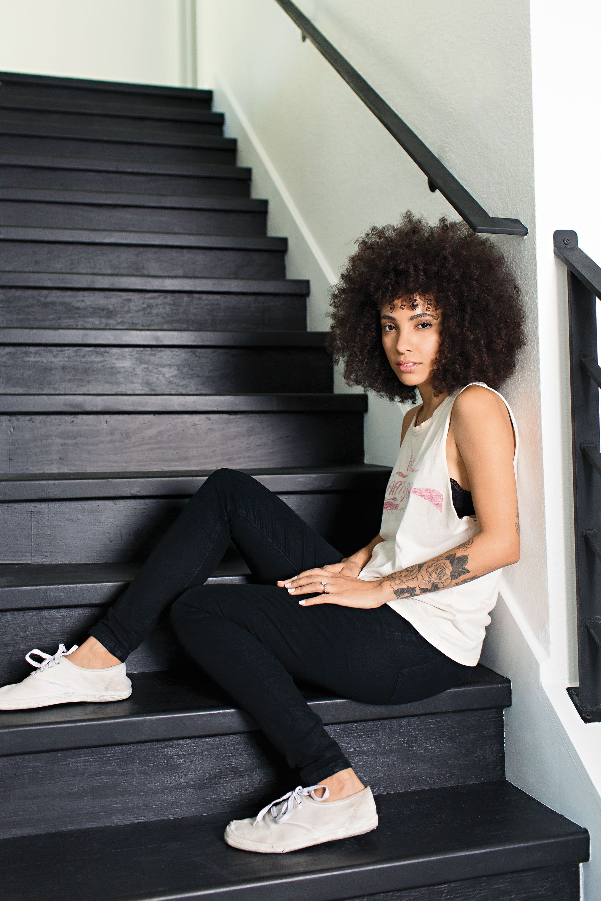 """<p>This Texas-based cofounder of lifestyle blog <em>Pineapple.life</em> grew up hating the texture of her voluminous, tightly curled hair. """"But today, people say, 'I wish I had hair like yours!' And that's wild.""""</p><p><strong>MY GOOD HAIR DAY: </strong>""""Honestly, the bigger the better! If your spirit is huge, your hair can be huge!""""</p><p><strong>WEEKEND ESSENTIAL: </strong>Every other week, Brunson uses Elucence clarifying shampoo, then smooths in Shea Moisture Jamaican Black Castor Oil leave-in conditioner. (She's also currently developing her own product line, Folie.) Then she air-dries: """"No blow-dryers.""""</p><p><strong>MORNING NEWS: </strong>""""I'll fluff out my hair with my fingers to help the curls separate. Then I use a little bit of argan oil on ends. This seals the cuticle and prevents breakage. It's the most important thing I do with my hair: Afterward, it's good to go.""""</p>"""