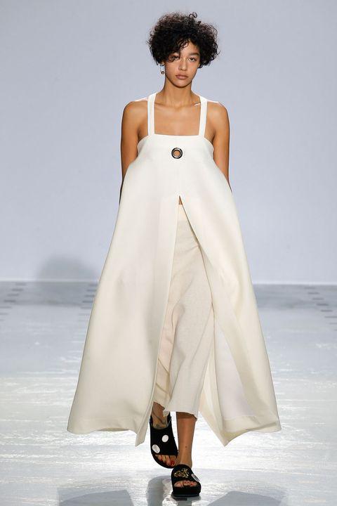 Shoulder, Joint, Dress, Jheri curl, Style, Fashion model, Fashion, Street fashion, One-piece garment, Fashion show,