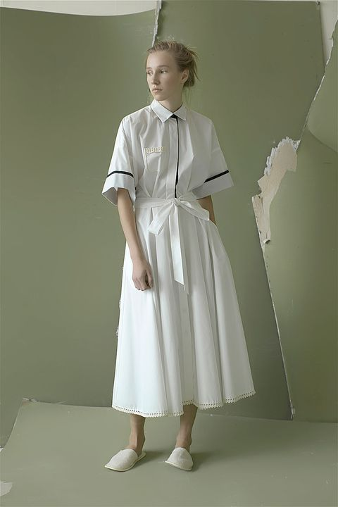 Sleeve, Dress, Standing, One-piece garment, Day dress, Pattern, Vintage clothing, Embellishment, Fashion design, Foot,