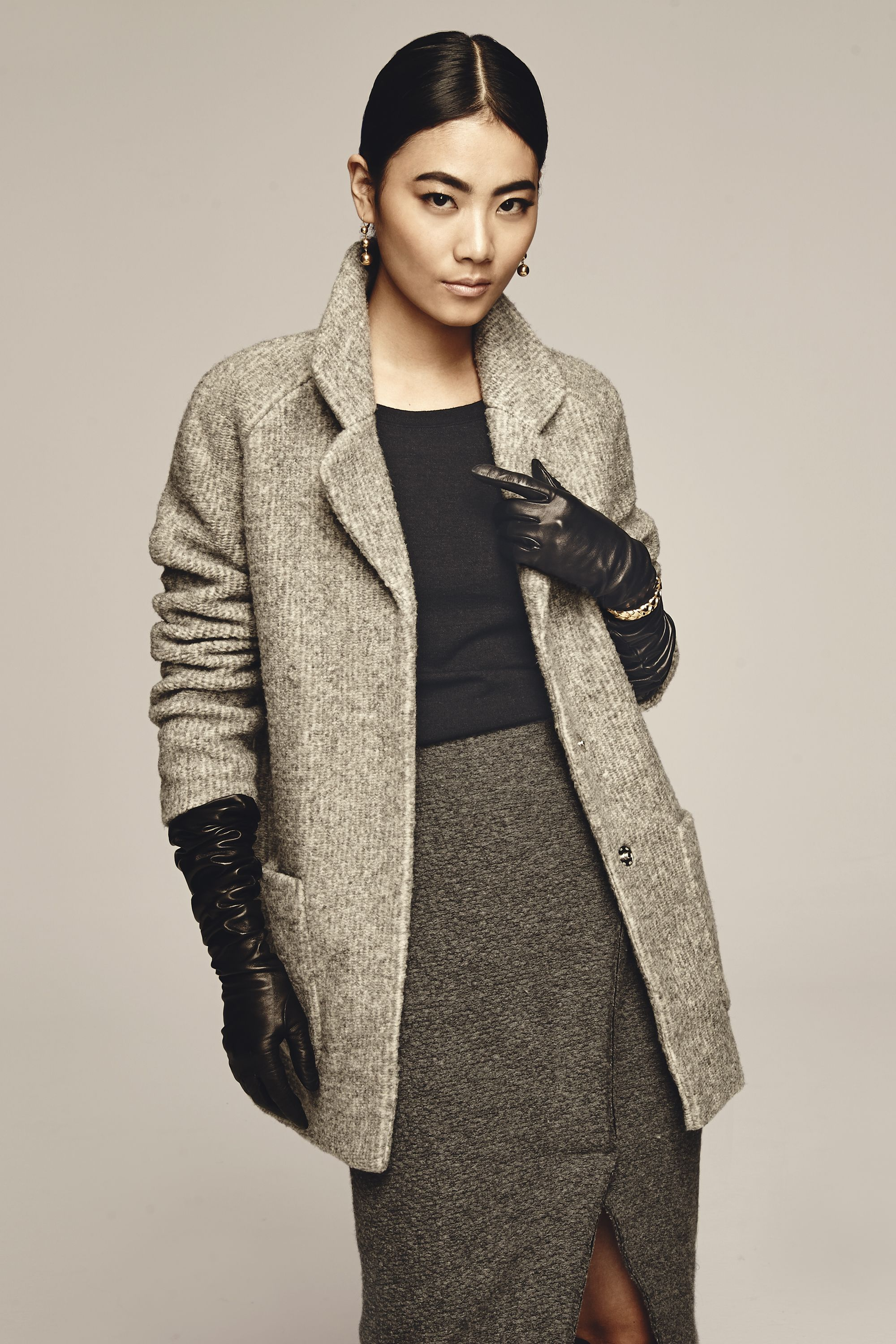 """<p><em></em> </p><p>Fake shorter sleeves by scrunching them up to the elbows, then slip on a pair of striking leather gloves to pick up the slack. Weather permitting, you can skip buttoning up and show off your indoor outfit. </p><p>Old Navy Textured Cocoon Coat, $75, <a href=""""http://oldnavy.gap.com/browse/category.do?cid=55474"""" target=""""_blank"""">oldnavy.com</a>; Old Navy Midi Sweater Dress (worn as a shirt), $40, <a href=""""https://ad.doubleclick.net/ddm/clk/296861937;123822730;o"""" target=""""_blank"""">oldnavy.com</a>; M.Martin Scalloped Wool Skirt, $395, <a href=""""http://mmartin.com/"""" target=""""_blank"""">mmartin.com</a>; Bloomingdale's Long Leather Gloves, $198, <a href=""""http://www1.bloomingdales.com/shop/product/bloomingdales-12-button-length-long-leather-gloves?ID=1112116&pla_country=US&cm_mmc=Google-PLA-ADC-_-Jewelry%20%26%20Accessories-NA-_-Bloomingdale%27s-_-886329823991USA&catargetid=120156070000286163&cadevice=c"""" target=""""_blank"""">bloomingdales.com</a>; Cé<span class=""""redactor-invisible-space"""">line Dot Straight Earrings, $425, <a href=""""http://www.celine.com"""" target=""""_blank"""">celine.com</a>; Jennifer Fisher Brass Medium Braid Cuff, $695, <a href=""""http://WWW.JENNIFERFISHERJEWELRY.COM"""" target=""""_blank"""">jenniferfisherjewelry.com</a></span></p>"""