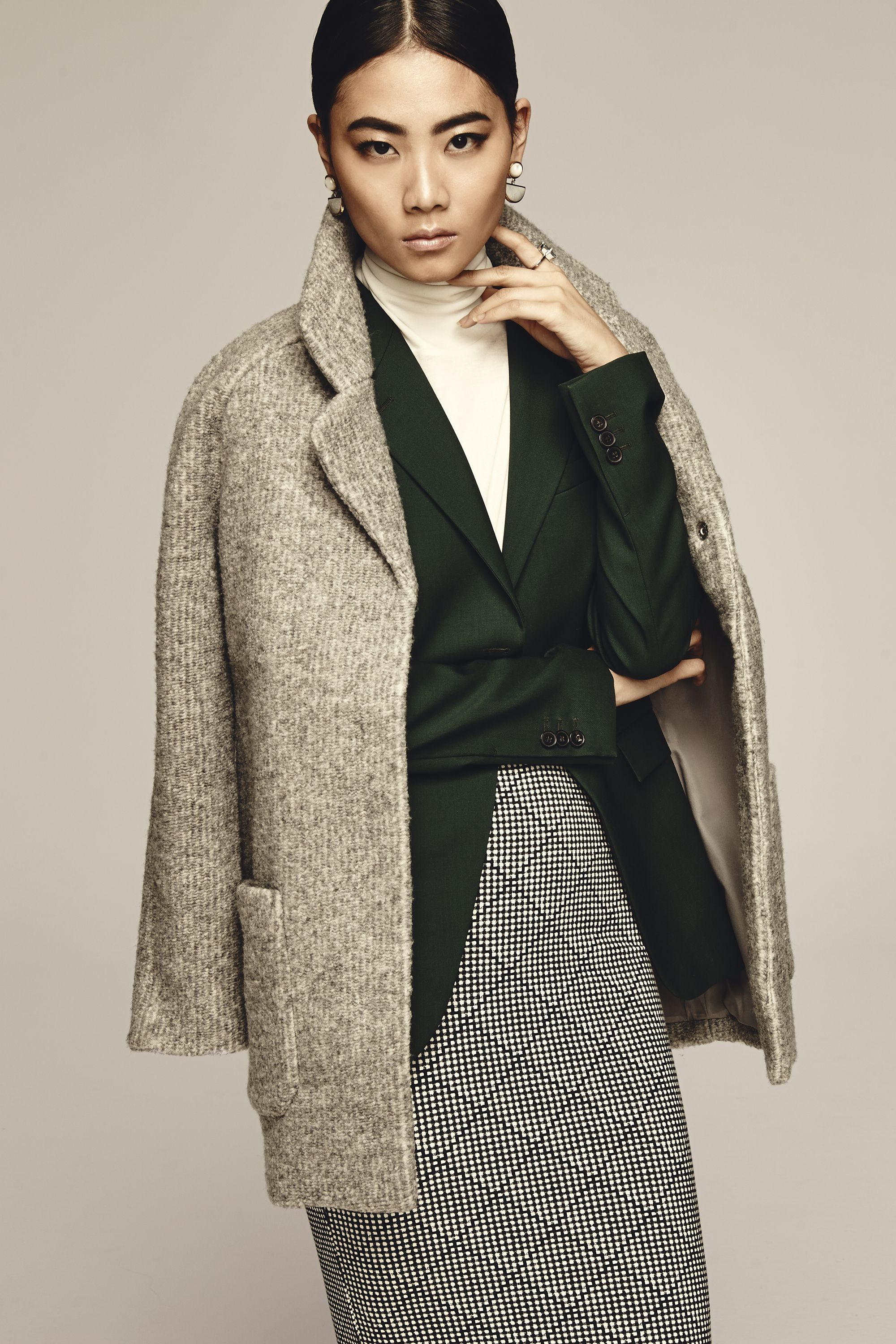 """<p>Sure, it's the cool way to wear a coat these days (thanks, street style stars!), but there's another benefit to lazily throwing your coat over your shoulders: You can show off a fitted blazer underneath.</p><p>Old Navy Textured Cocoon Coat, $75, <a href=""""http://oldnavy.gap.com/browse/category.do?cid=55474"""" target=""""_blank"""">oldnavy.com</a>; Jil Sander Blazer, $1,910, <a href=""""http://store.jilsander.com/us/jil-sander/jacket_cod41581379fx.html"""" target=""""_blank"""">store.jilsander.com</a>; Equipment Oscar Turtleneck Sweater, $320, <a href=""""https://www.net-a-porter.com/product/598043/Equipment/oscar-cashmere-turtleneck-sweater"""" target=""""_blank"""">net-a-porter.com</a>; Old Navy Patterned Midi Pencil Skirt, $10, <a href=""""https://ad.doubleclick.net/ddm/clk/296862303;123822729;k"""" target=""""_blank"""">oldnavy.com</a>; Efva Attling Bend Over Ring, $8,500, <a href=""""http://www.efvaattling.com/bend-over-ring-gold-aquamarine-diamonds/p/1427"""" target=""""_blank"""">efvaattling.com</a>; Lizzie Fortunato Geometry Earrings, $300, <a href=""""http://www.neimanmarcus.com/Lizzie-Fortunato/Designers/cat52710755/c.cat"""" target=""""_blank"""">www.neimanmarcus.com</a></p>"""