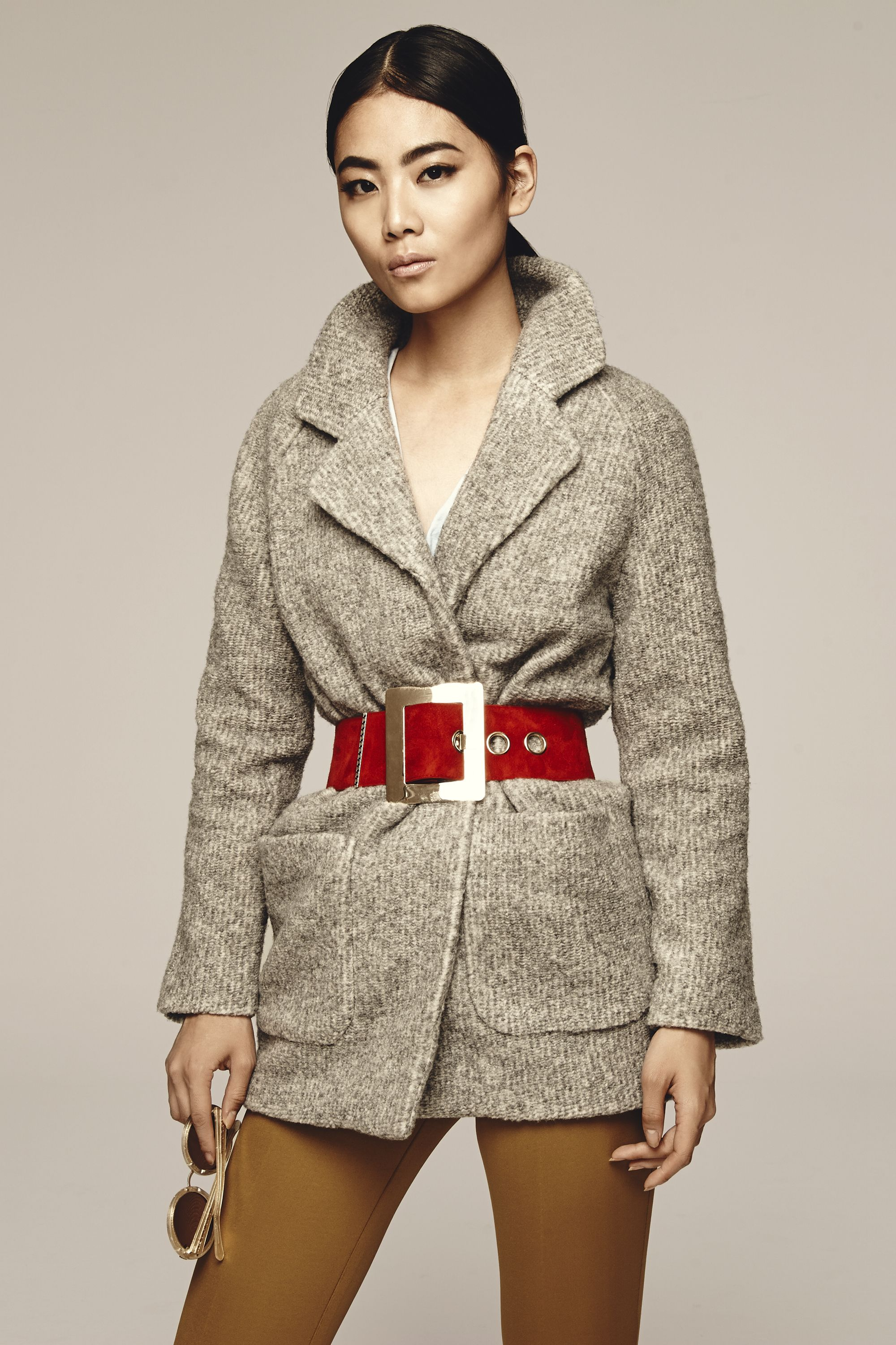 """<p>Make a boxy coat feel more feminine by tucking one side into the other, and cinching it at the waist with a bold-colored belt (with a decidedly oversize buckle). It'll give bundled-up you a much sexier silhouette.</p><p>Old Navy Textured Cocoon Coat, $75, <a href=""""http://oldnavy.gap.com/browse/category.do?cid=55474"""" target=""""_blank"""">oldnavy.com</a>; Prada Double Jersey Pants, $940, <a href=""""http://www.prada.com/en.html?cc=US"""" target=""""_blank"""">prada.com</a>; Old Navy Classic Oxford Shirt, $25, <a href=""""https://ad.doubleclick.net/ddm/clk/296862302;123822728;i"""" target=""""_blank"""">oldnavy.com</a>; Versace Suede Belt, $783, <a href=""""http://www.matchesfashion.com/us/products/1025995?country=USA&LGWCODE=1025995000003;104033;6167&qxjkl=tsid:15858