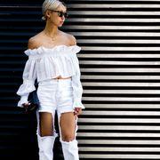 Clothing, Fashion model, Street fashion, Waist, Parallel, Headpiece, Model, Fashion design, Embellishment, Knee-high boot,