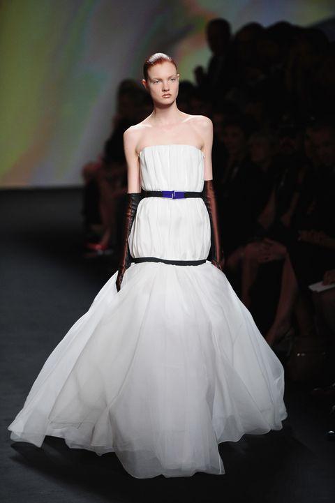 Clothing, Gown, Fashion model, Dress, Wedding dress, Fashion, Bridal clothing, Haute couture, Shoulder, Fashion show,