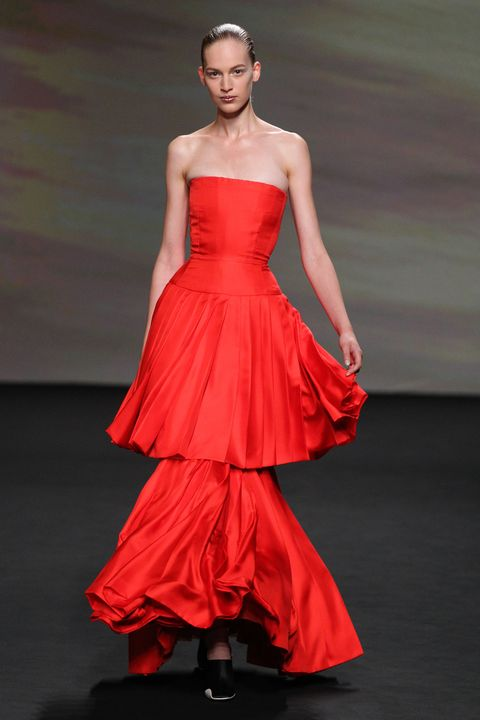 Fashion model, Dress, Clothing, Gown, Fashion, Fashion show, Haute couture, Shoulder, Strapless dress, Red,
