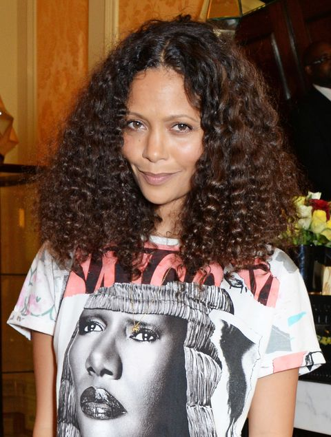 "<p>To keep curls buoyant, ""I rarely use shampoo,"" says Thandi Newton, who simply rinses weekly with John Masters Organics Lavender & Avocado Intensive Conditioner and applies Kérastase Elixir Ultime hair oil to moisturize ends. When she wants extra definition, Newton sleeps in braids, then goes over her hair with Tancho stick wax to preserve the shape.</p>"