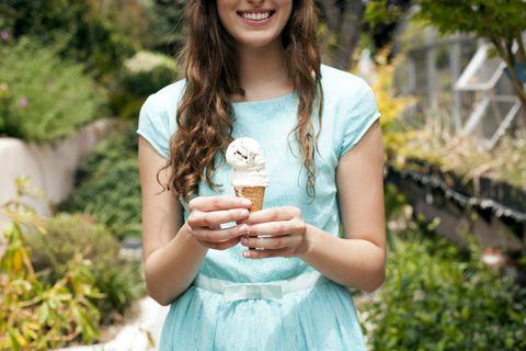 Woman in dress holding ice cream