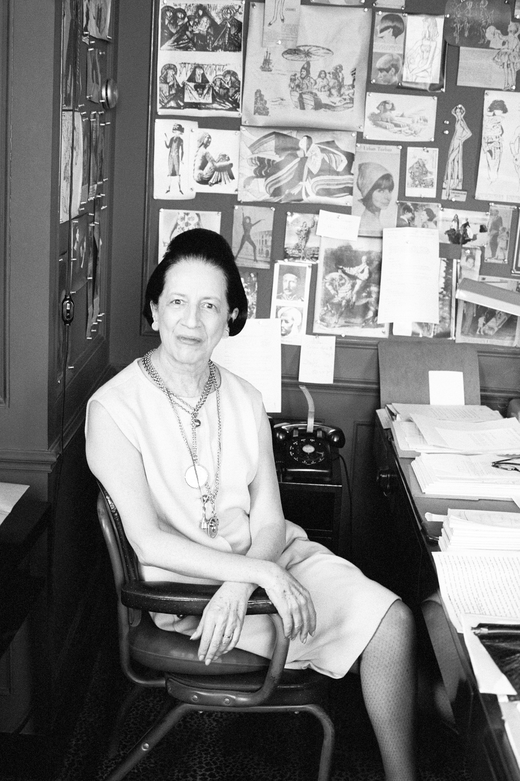 """<p>In 1922, at the age of 25, Vreeland was featured by her future employer, <em>Vogue</em>, in a roundup of socialites with their cars. The story cheekily read, """"Such motors as these accelerate the social whirl. Miss Diana Dalziel, one of the most attractive debutantes of the winter, is shown entering her Cadillac."""" Shortly after, Vreeland moved to London, where she joined a dance company. Like other society women at the time who ran their own boutiques, Vreeland decided to open up a lingerie business. The stunning socialite would soon become one of the most legendary fashion editors of all time, and one of <em>BAZAAR</em>'s greatest. <span></span></p>"""