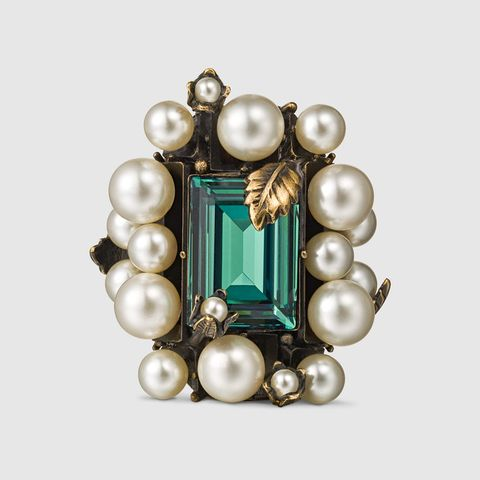 """<p>Gucci Ring With Crystal and Pearls, $875; <u><a href=""""http://www.gucci.com/us/en/pr/women/womens-silver-fashion-jewelry/womens-rings/ring-with-crystal-and-pearls-p-404843J1D518521?position=3&listName=ProductGridWComponent&categoryPath=Women/Womens-Silver-Fashion-Jewelry"""" target=""""_blank"""">gucci.com</a></u></p>"""