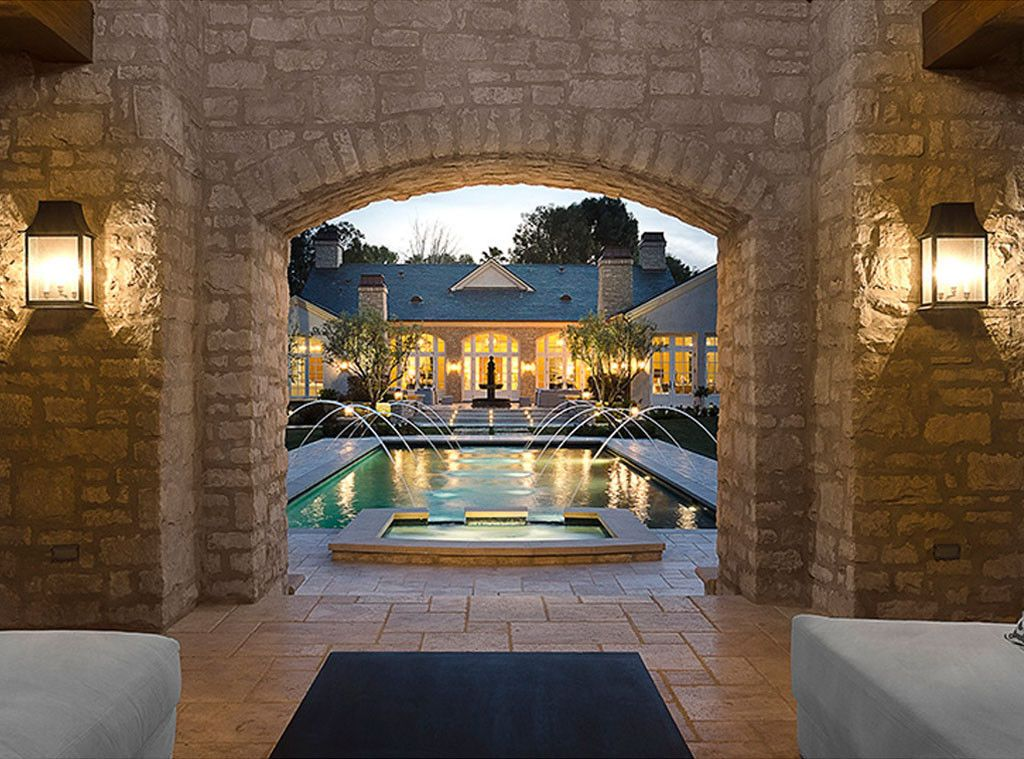 Stone pavilion area and pool at #Kimye estate: Interior Design: Kim Kardashian & Kanye West's French Country Home