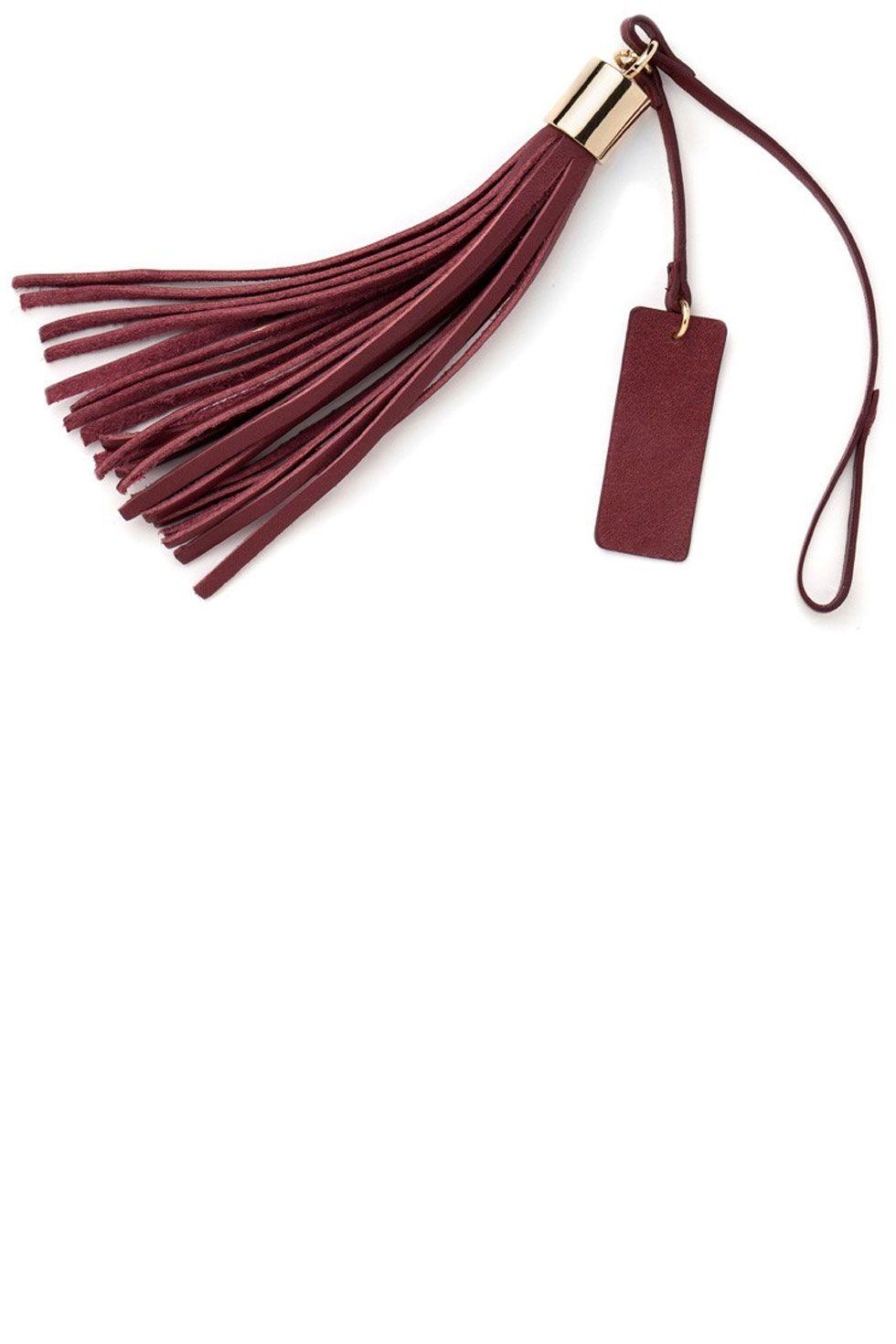 "<p>Cuyana Leather Bag Tassel, $35; <a href=""http://www.cuyana.com/leather-bag-tassel-wine.html"">cuyana.com</a></p>"