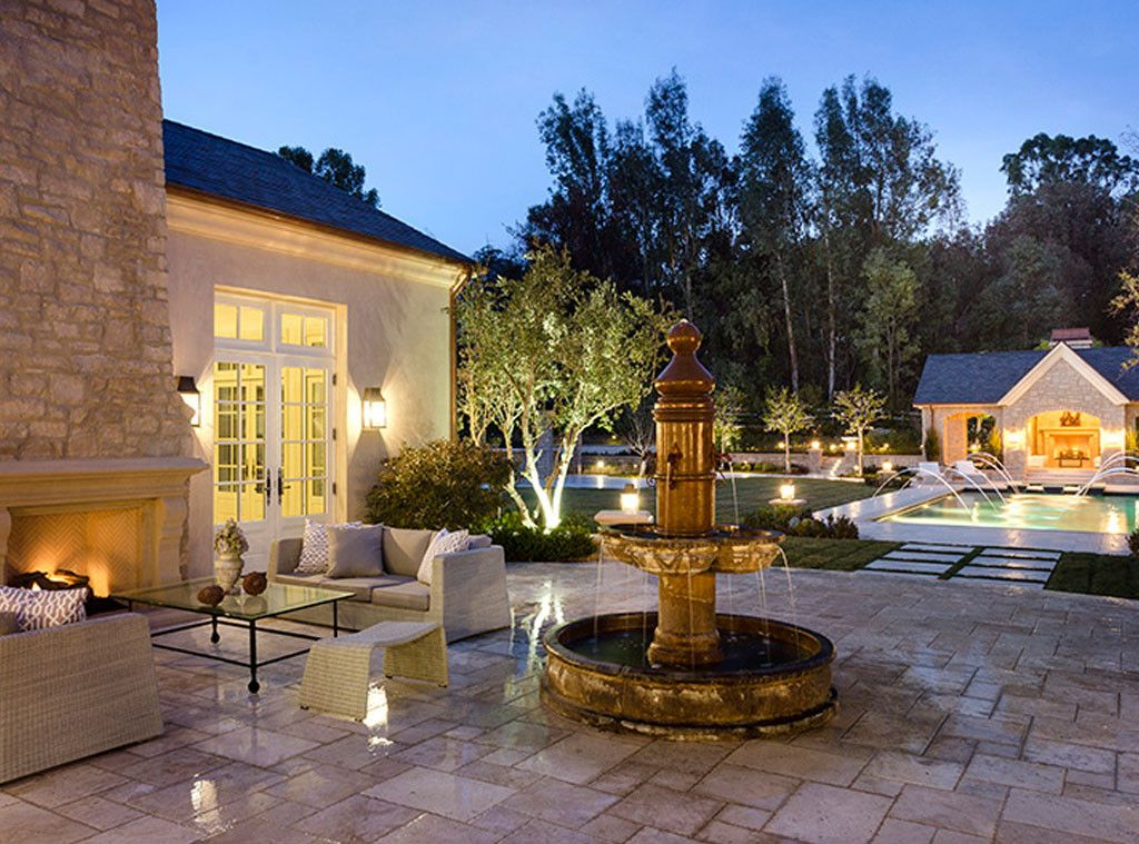 Fountain and patio at #Kimye estate: Interior Design: Kim Kardashian & Kanye West's French Country Home