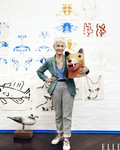 """<p>Joan Jonas, a diminutive woman with a forceful presence, reconfirmed her status as a high priestess of the avant-garde earlier this year with <em>They Come to Us without a Word</em>, an ecologically themed multimedia installation and performance piece that was arguably the biggest hit of the 2015 Venice Biennale—""""a triumph,"""" declared the<em> New York Times</em>. Originally trained in sculpture, by the late '60s Jonas was ensconced in the experimental art scene of downtown New York and was exploring a host of other mediums. In the 1970 performance piece <em>Mirror Check</em>, she examined herself, naked, with a mirror, intending to present a woman reclaiming her body. In the 1972 video piece <em>Organic Honey's Vertical Roll</em>, the artist, wearing a doll-like mask, caricatured femininity with a series of dainty movements. Jonas's interests, though, encompass not just the roles women play but also folk tales, rituals, and humans' impact on the natural world. The result is an ever-expanding collection of works that incorporate everything from drawing to soundscape to projection, often all at once, and have an almost mesmerizing sensory power. """"Before I could think of myself as an artist, I had to find my own language,"""" she says. """"I'm still experimenting with how to make images.""""</p><p><em>Joan Jonas in her Soho loft with a Mexican mask and drawings of dogs and bees—animals are a recurring motif in her work. Styled by David Vandewal</em></p>"""