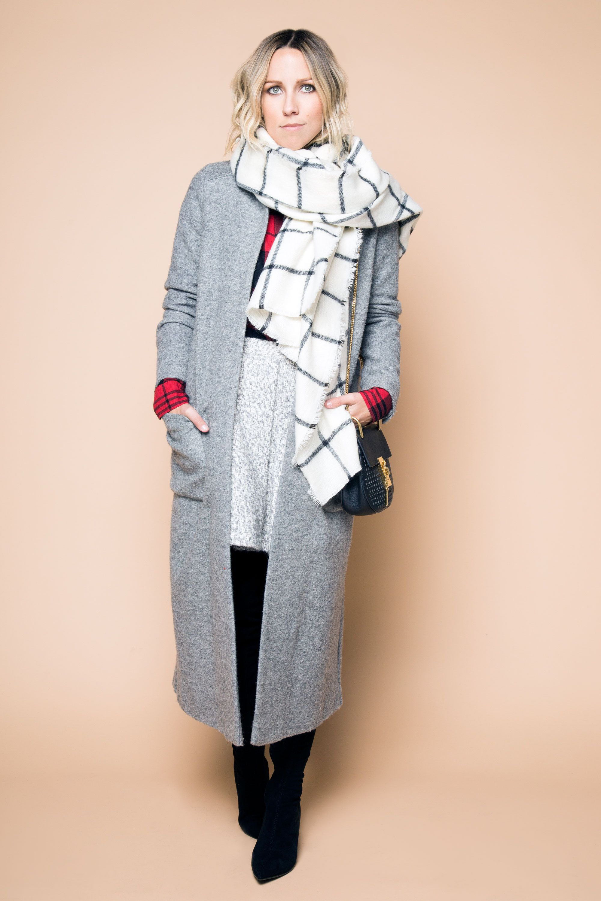 "<p>Observe: opposite sizes, opposite patterns, opposite everything. ""A larger, simpler windowpane print in a neutral shade works well against a smaller, busier print in a more dominant color,"" Duprie says. ""Keep everything else monochromatic and muted—the plaids are the stars here.""</p>"