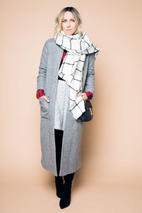 """<p>Observe: opposite sizes, opposite patterns, opposite everything. """"A larger, simpler windowpane print in a neutral shade works well against a smaller, busier print in a more dominant color,"""" Duprie says. """"Keep everything else monochromatic and muted—the plaids are the stars here.""""</p>"""