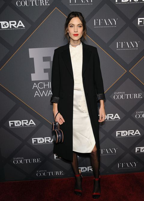 "<p>Who: Alexa Chung</p><p>When: December 2, 2015</p><p>Why: Named <a href=""http://footwearnews.com/2015/fashion/celebrity-style/fn-achievement-awards-2015-fnaa-red-carpet-shoes-style-kanye-west-alexa-chung-173774/"" target=""_blank"">the 2015 Style Influencer by Footwear News</a>, Alexa Chung proved her worth in a perfectly styled white dress and black coat combo. Cherry red Gianvito Rossi heels, a crystal-embellished Lucite choker, and an adorable Hillier Bartley bunny clutch highlight her killer sense of accessorizing. </p>"