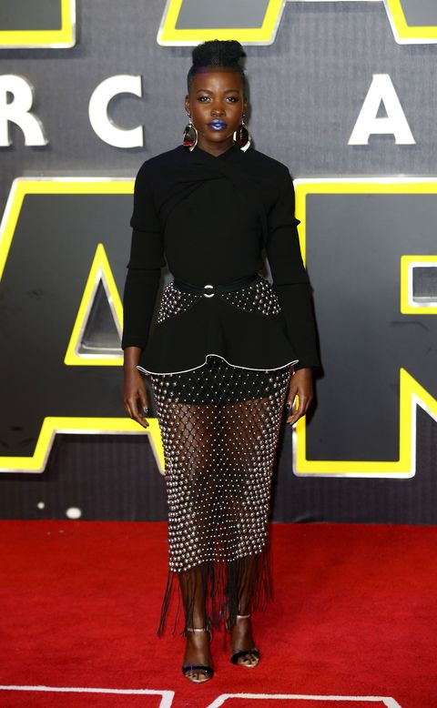"<p>Who: Lupita Nyong'o</p><p>When: December 16, 2015</p><p>Why: Lupita Nyong'o has taken the <em>Star Wars </em>theme quite literally this press tour, with flashing LED lights and sparkling gowns, but we're not complaining. We can't imagine this futuristic Proenza Schouler dress and <a href=""http://www.elle.com/beauty/news/a32659/lupita-nyongo-blue-lips/"">deep blue lips</a> looking this good on any other actress. </p>"