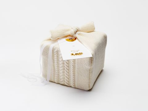"""<p>""""Knitted with Italian wool from our Fall 2015 collection, we created a gift wrap with The Knit Resource center that warms up a cold New York winter and can be used again and again."""" <em>—  Alejandra Alonso, <em>A Moi designer</em></em></p>"""