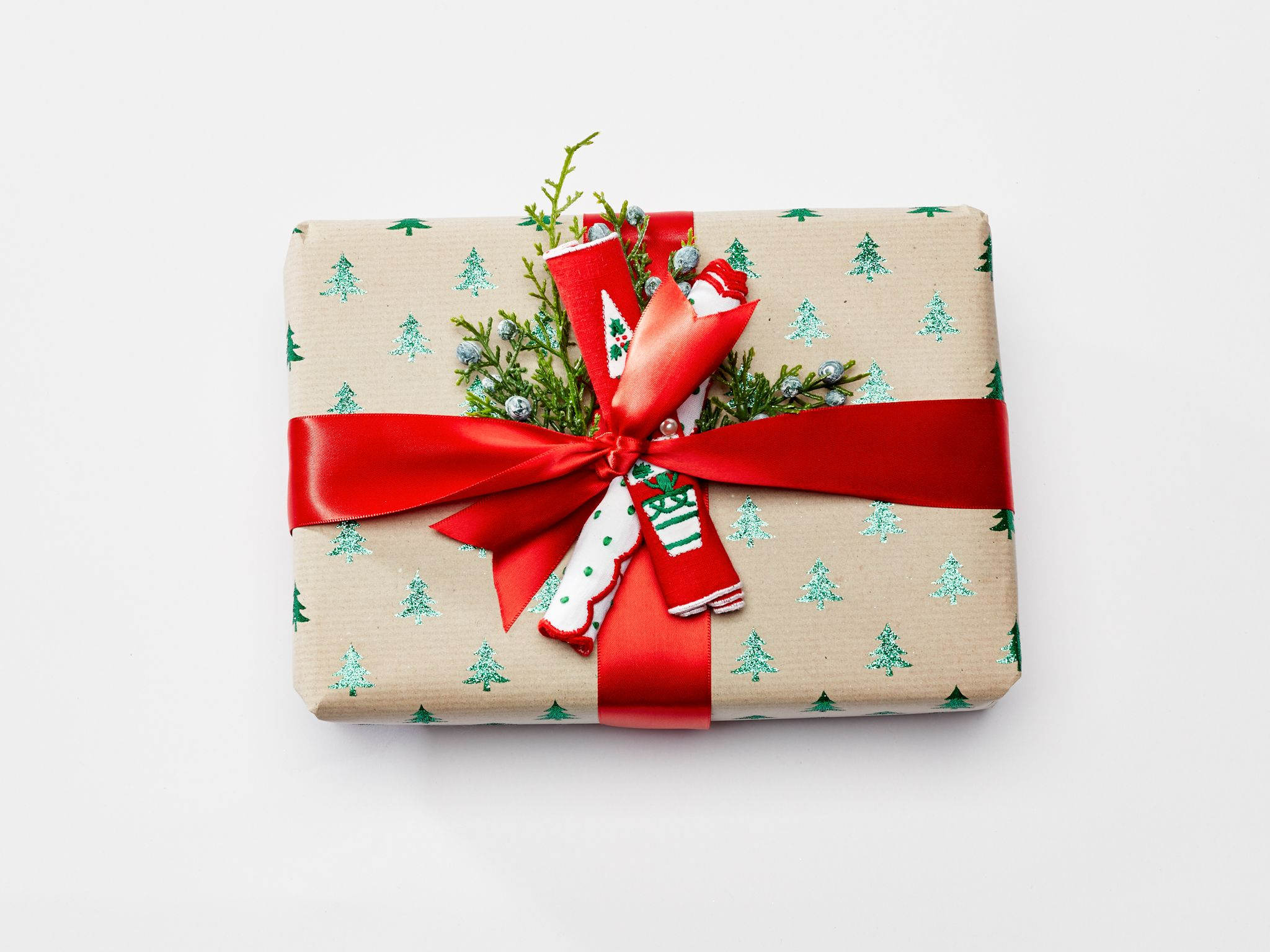 how 13 designers gift wrap holiday presents