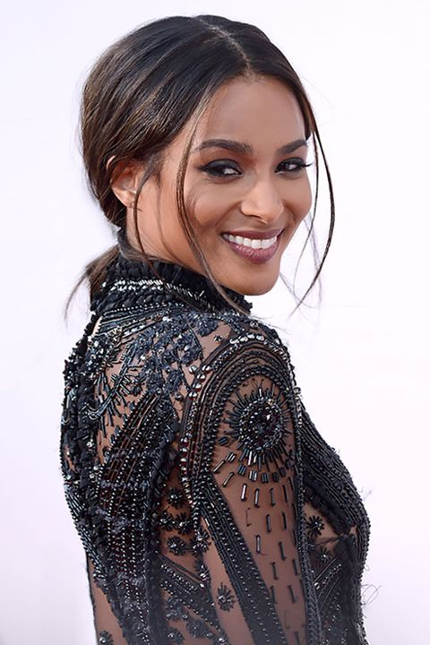 """<p>Ciara's hairstylist, <a href=""""http://www.elle.com/beauty/hair/a32591/ciara-schoo..."""" target=""""_blank"""">Cesar Ramirez</a>, created a laser precise <a class=""""body-el-link standard-body-el-link"""" href=""""http://www.elle.com/beauty/hair/news/g27202/celebrity-hair-middle-parts/"""" target=""""_blank"""">center part</a> and gathered hair back into a ponytail: """"The trick is to not pull the hair all the way through the elastic,"""" he explains. """"Leaving the hair in a loop creates something between a pony and a knot."""" </p>"""